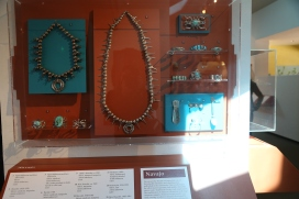 Navajo jewelry, emphasizes elaborate silverwork with large turquoise nuggets