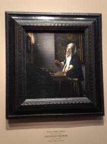 Woman Holding a Balance - Vermeer